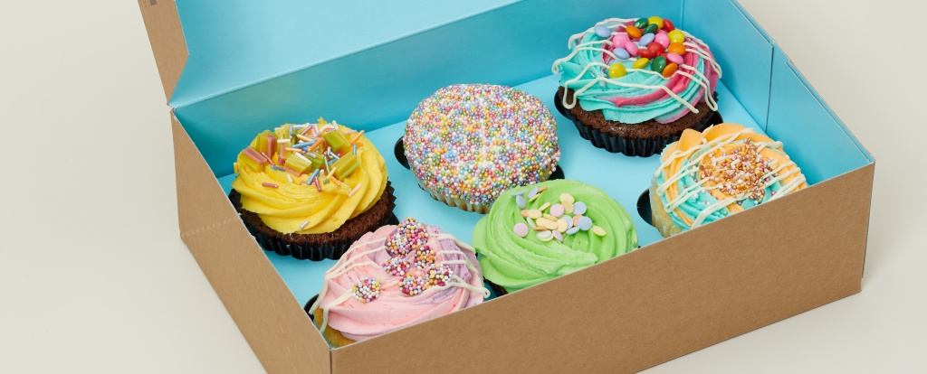 Box of colourful cupcakes from Lola's
